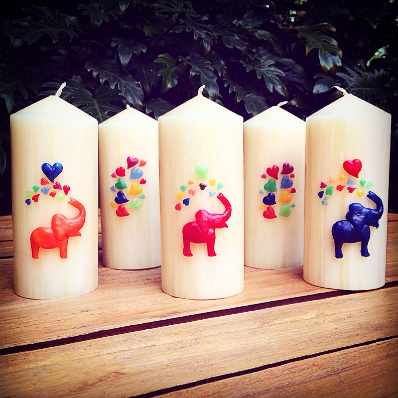 """Valchiria limited edition ephemoral art designs """"Elephant Joy"""" and """"Column of Hearts"""". Beeswax blend relief sculpture mounted on pillar candles."""